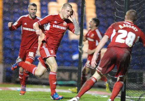 Swindon Town striker James Collins scores the winner against Colchester