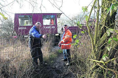 From left, Brian Pound and Dave Peacey of Swindon and Cricklade railway warn about crossing the tracks