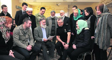 Wiltshire police at Habib Islamic Mosque and cultural centre. Shahid Khan third left, leads the discussions with Imam Zahid Mohd behind and to the left of Shahid and Abdul Latif and Syed Naqui back centre