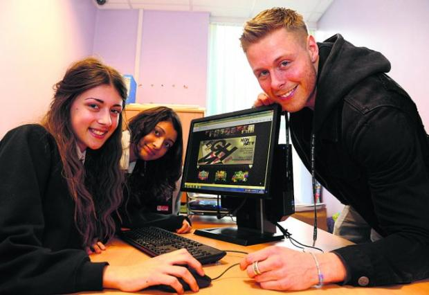 PROJECT DJ Mark Eteson at Kingsdown School with pupils Daisy and Kamya                                  Picture: DAVE COX
