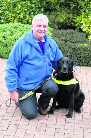Alan Fletcher, who is chairman of Swindon Guide Dogs, with his guide dog Joy