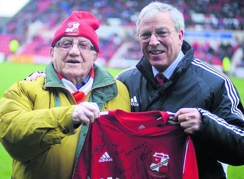 John Tulley receives a signed Town shirt from Don Rogers, on his 93rd birthday