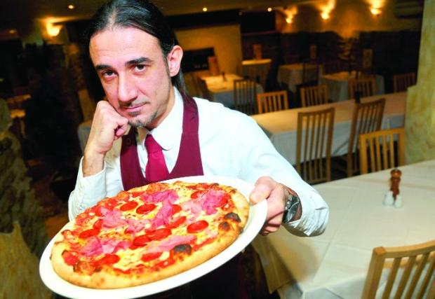 FOOTBALLERS' FAVOURITE Vincenzo De Iure with a Di Canio pizza at Fratello's restaurant in Regent Circus    	                     Picture: JAMES DOUGLAS
