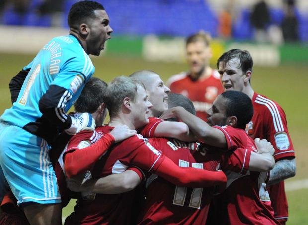 Town celebrate Gary Roberts' astonishing second goal at Tranmere