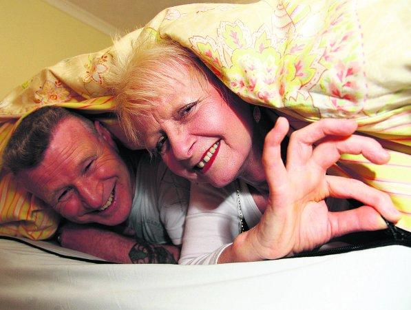 Swindon Advertiser: BEDDED BLISS Roger and Sonia Boswell under the zipped duvet Sonia has created to put an end to bedtime battles