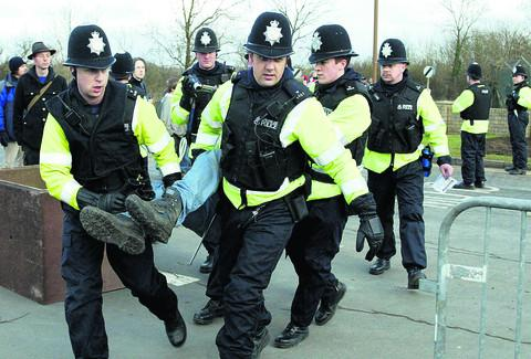 A protester is arrested at RAF Fairford