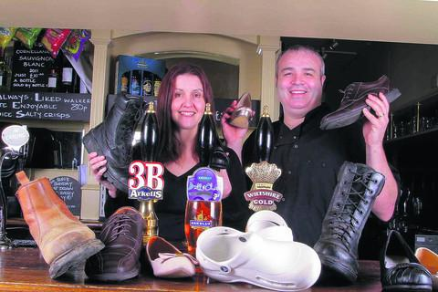 Arkell's will throw open its doors on March 14 from 1pm to 8pm when it encourages people wanting their own business to take their first steps to running a pub. Pictured are Julie and Andy Moss, of The Sun at Coate Water