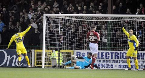 Bury score the winner against Swindon Town at the County Ground last night