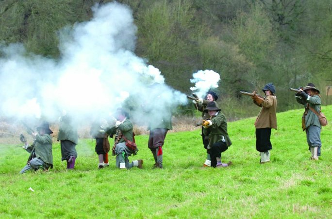 MUSKETEERS Shrouded in gunpowder, members of The Sealed Knot, the society of Cavaliers and Roundheads, recreate a scene from a Civil War battle