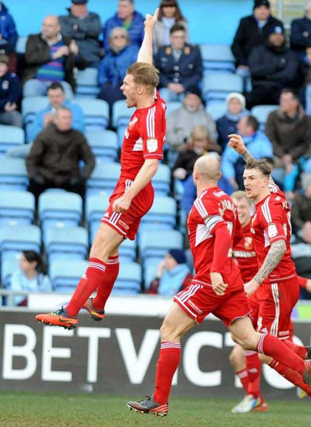 Darren Ward goes wild after heading Town's winner