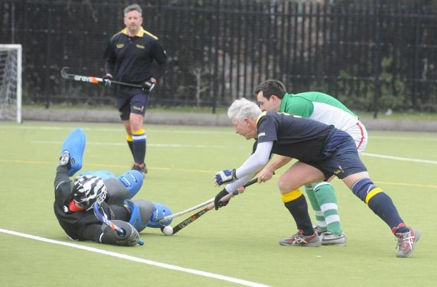 Tom Wilson (green) in action for North Wilts against Bath Buccs F