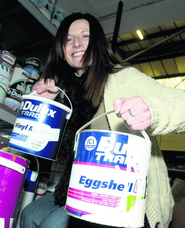 Project manager Olivia McCann with some pots of paint