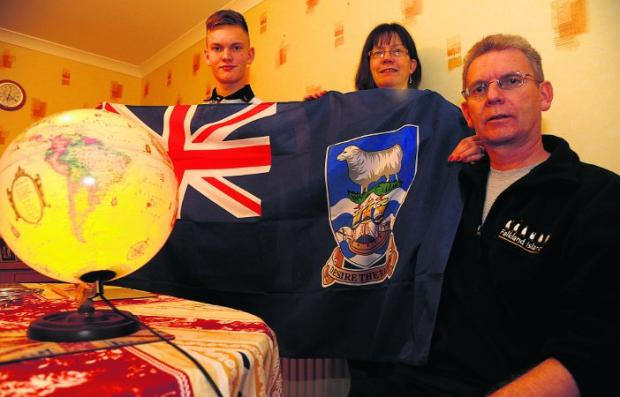 Swindon Advertiser: UNITED WE STAND Terry Allen, pictured with his wife Maxine and son Jack, believes the Falklands should stay part of the United Kingdom   Picture: DAVE COX
