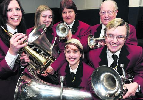 Swindon Brass members, clockwise from front centre, Elizabeth Homewood, Jo Dilley, Rachael Workman, Irene Bailey, musical director Francis Cowley and Cheryl Cowley