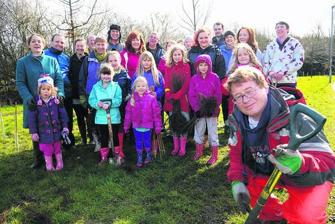 Stratton parish councillor Roger Smith, right, with the group who went tree planting at Watermead r