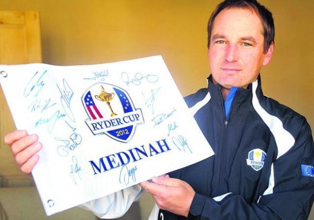 Get bidding  Jason Hempleman is set to auction an autographed golf flag to raise cash for charity Picture: James Douglas