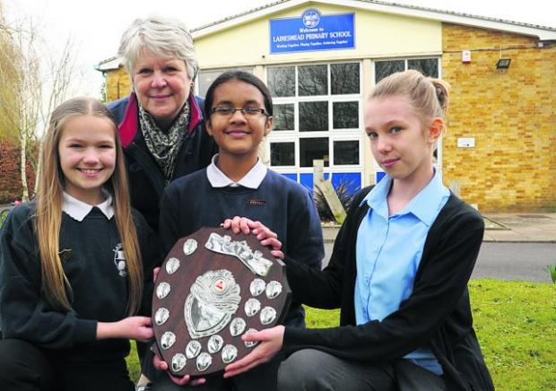 ROAD SENSE Lainesmead Primary School pupils who won the junior road safety quiz. From left, Joanna, council road safety manager Margaret Tester, Divya and Sinead   Picture: DAVE COX