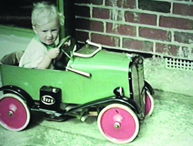 NICE MOTOR Little Tony Winslow plays in his toy car at his home in Downs View Road, Swindon in 1939.