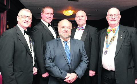 Pictured at  the Rotary Club's sporting dinner are David Houghton, the  Rotary district governor, Phil Vickery, Michael Lowe, of Hop, Skip and Jump, comedian Adger Brown and Rotary president Peter Hayman
