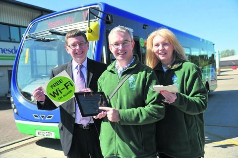 Swindon Advertiser: Thamesdown Transport is introducing free wi-fi on some of its routes. Pictured l to r are Paul Jenkins, Keith Smith and Maureen Corcoran