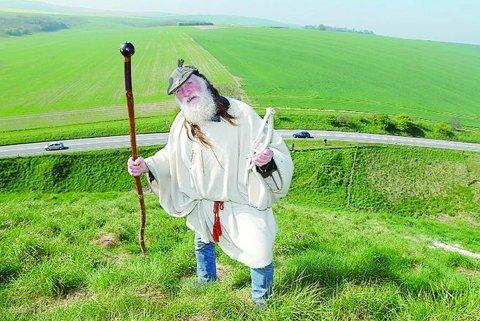 Staff in one hand antler pick in the other, Terry Dobney, the Arch Druid of Avebury, strides aloft the monumental hillock in May, 2008 to mark the completion of the £1.7mi scheme to preserve the structure's shape and integrity