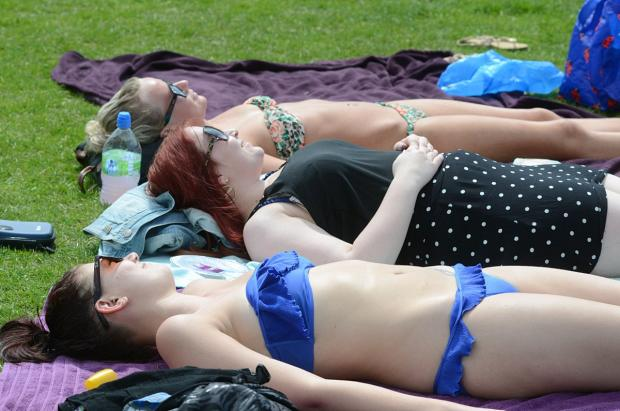 Sunbathers are warned to use sunscreen and wear sunglasses if outdoors for more than 20 minutes