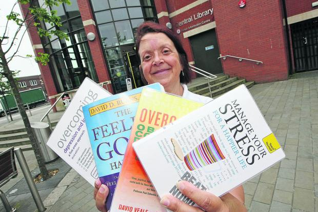 Frances Hambidge, Swindon Libraries stock librarian, with some new self-help books that could help people with conditions such as depression and anxiety