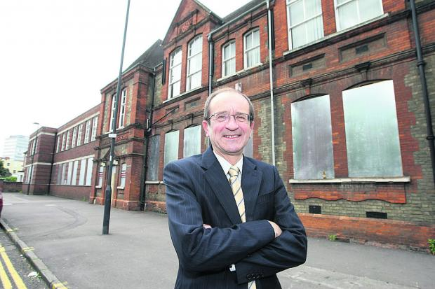 Coun Brian Mattock, outside Sandford House in the town centre