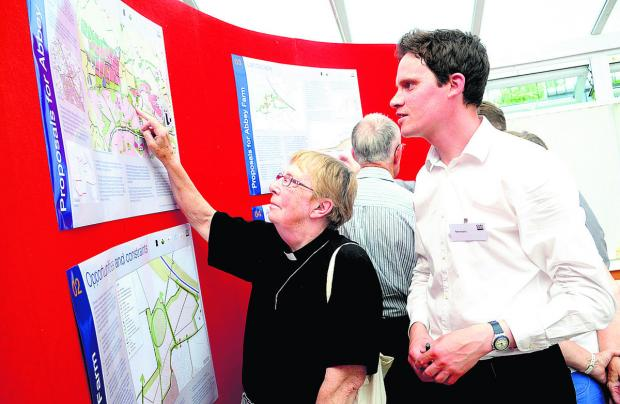 Residents looking at previous plans for Abbey Farm