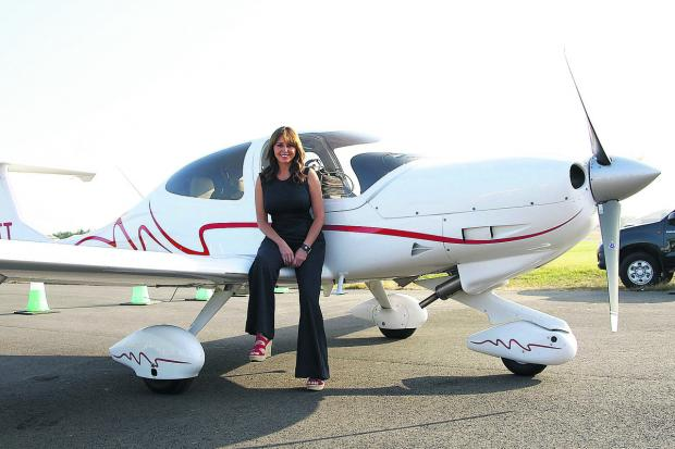 Carol Vorderman touched down on board the first arrival at this year's Royal International Air Tattoo, at RAF Fairford, Gloucestershire, to open the show – and to get in some practice for her own flying venture next year
