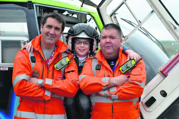 Max Deans, nine,  with the Great Western Air Ambulance crew that saved his life after he was was knocked over by a bus in Febuary in Haydon Wick