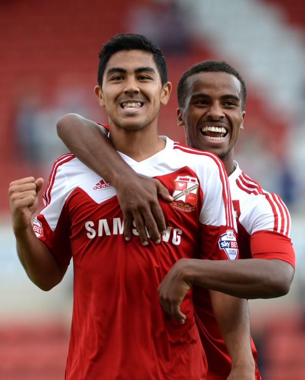 Swindon Advertiser: Town's Massimo Luongo, left, celebrates his goal with Nathan Byrne
