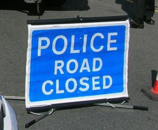 Road closed as overturned truck is recovered