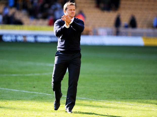 Swindon Advertiser: Swindon Town boss Mark Cooper at Molineux on Saturday