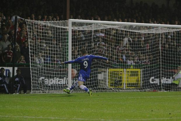 Fernando Torres scores for Chelsea against Swindon Town in the third round of the Capital One Cup last season. Town are hoping to land a big side in round two of this year's competition when the draw is made tonight