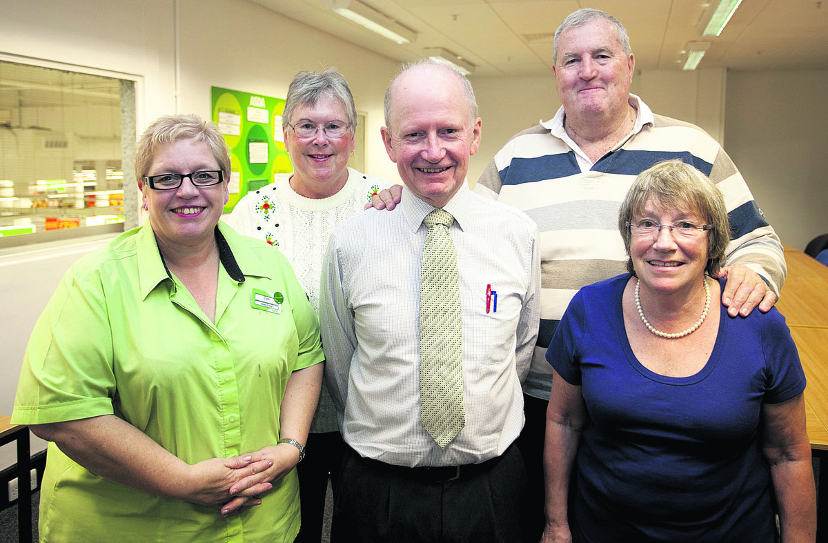 ick Hilling, centre, with left, Jan Kirby, of Asda, Judy Fenton, Rob Fenton and Joan Haddrell