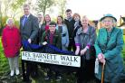 rom left, Eileen Arkley, council leader David Renard, MP Robert Buckland, Claire Ellis, Charlie Wicks, Alison Pewsey, Jack Wicks, Sara Wicks, Sandra Barnett and Ruby Sambler at Rex Barnett Way, named in tribute to the former mayor