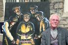 Ken White with his new painting The Rivet Hotters, which the Steam Museum has acquired