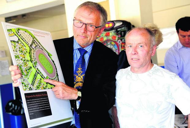 From left, Clarke Osborne and Roger Wheeler at a public consultation at the Abbey Stadium on plans to build houses at the site