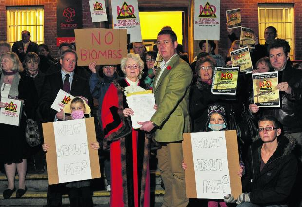 Swindon Advertiser: Protesters hand over the petition