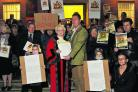Paul Saunders presents the petition to Deputy Mayor Teresa Page