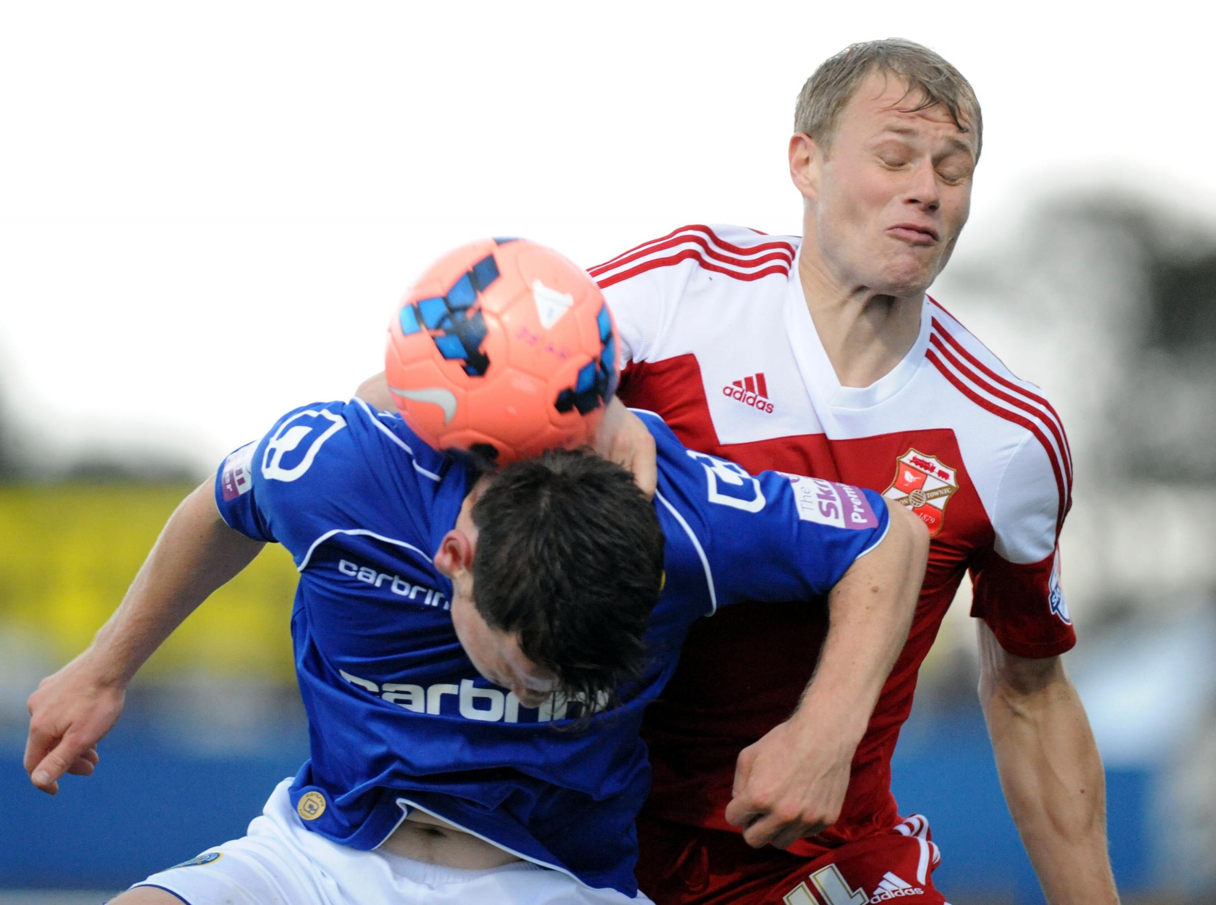 Jay McEveley has a knee injury and won't travel with Swindon Town to Crewe