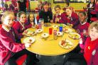 Above, from left  Abi-Jae, Zoe, Kaci, Susannah McWilliam, Elliot, Abigael, Penuel and Elle tuck in                                                                 Pictures: Alex Skennerton