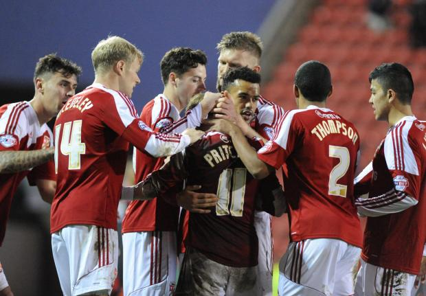 Swindon Advertiser: Town's players celebrate their second goal against Carlisle, scored by Alex Pritchard