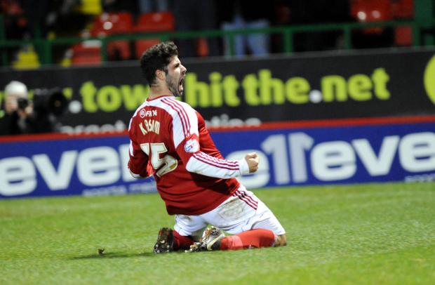 Swindon Advertiser: Yaser Kasim celebrates his goal against Coventry