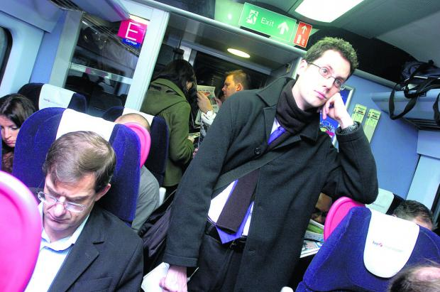 A crowded train pulls out of Swindon train station