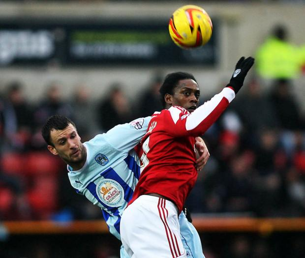 Swindon Advertiser: Nile Ranger challenges with Coventry's Dan Seabourne