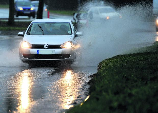 Swindon Advertiser: Traffic had to battle through perilous conditions as another storm blew in yesterday morning
