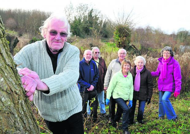 Wroughton Parish Council chairman Paul Hurst with councillors and campaigners who are raising money to buy Kings Farm Wood