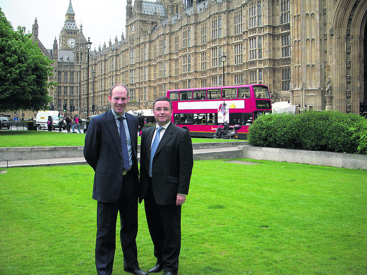 North Swindon MP Justin Tomlinson with his South Swindon colleague Robert Buckland outside the Houses of Parliament